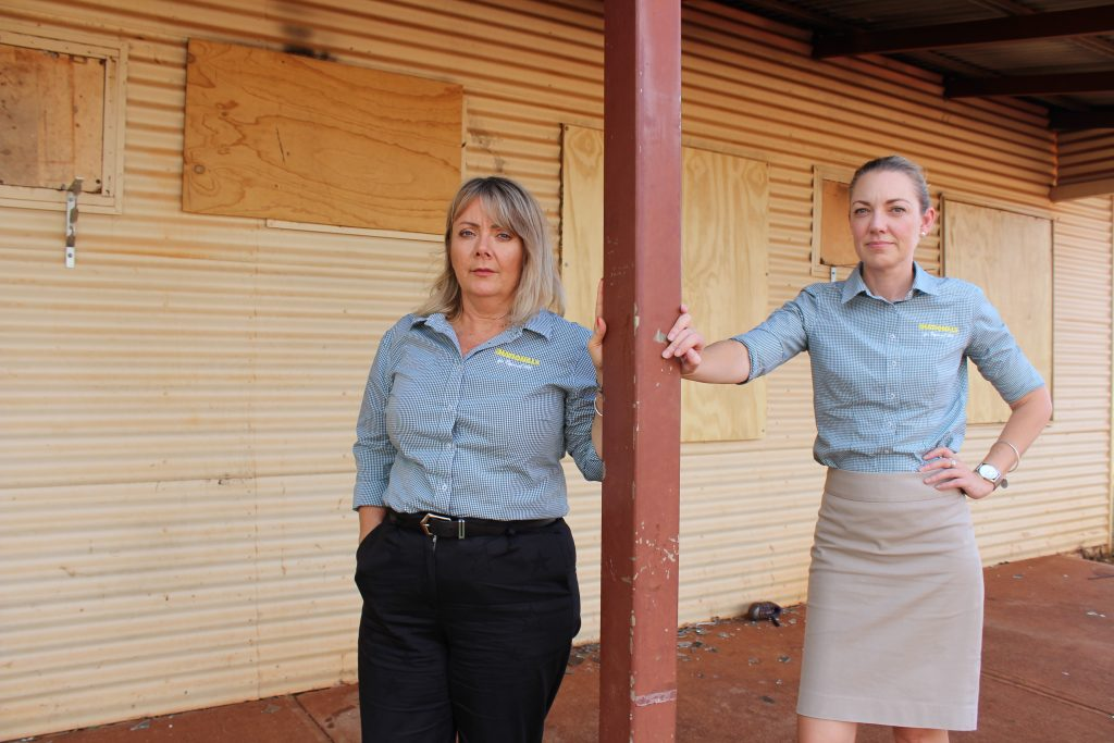 Mia Davies and Jacqui Boydell at one of the many abandoned BHP homes